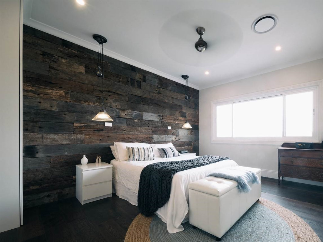 Recycled timber cladding and feature wall in bedroom by Simply Wood