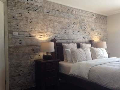 Simply Wood Wall Whitewashed and Wire brushed sleeper on black backing board - Sydney